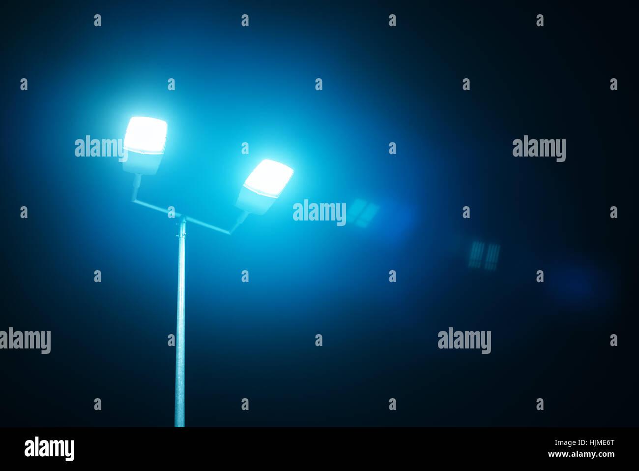 Outdoor sport court or stadium lights against dark night sky stock outdoor sport court or stadium lights against dark night sky aloadofball Gallery