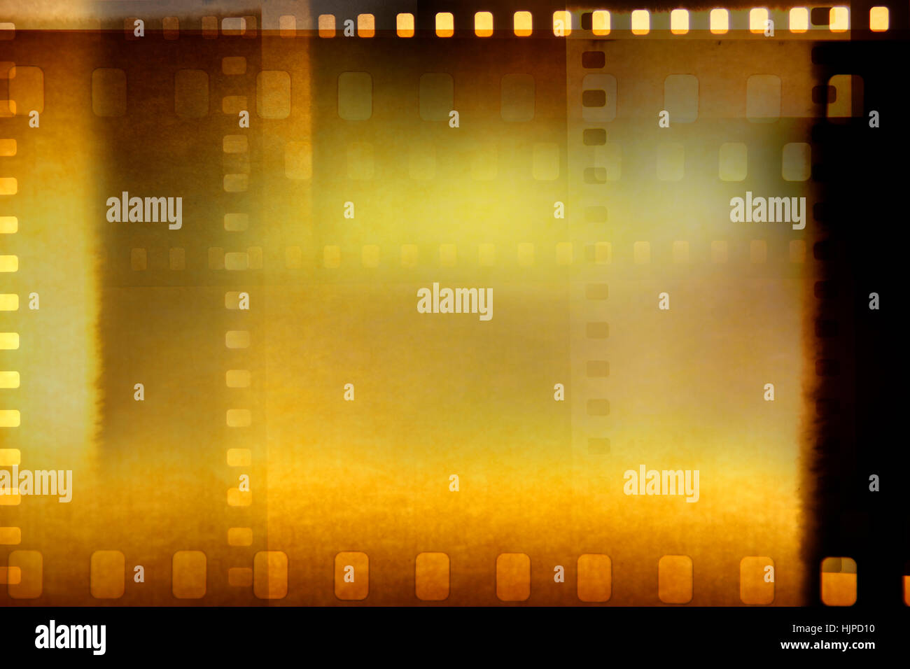 Film negative frames on brown background Stock Photo ...