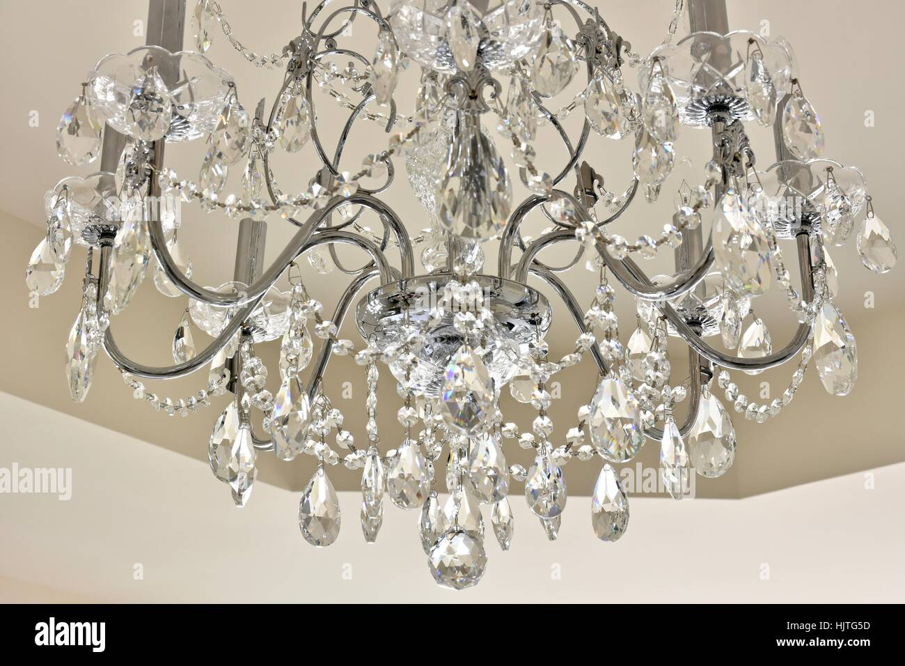 Crystal chandelier hanging from the ceiling of a master bedroom crystal chandelier hanging from the ceiling of a master bedroom arubaitofo Images