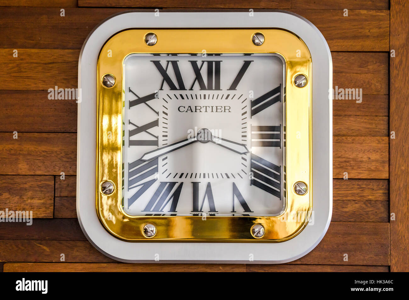 Luxury cartier square wall clock on a wooden wall stock photo luxury cartier square wall clock on a wooden wall amipublicfo Images