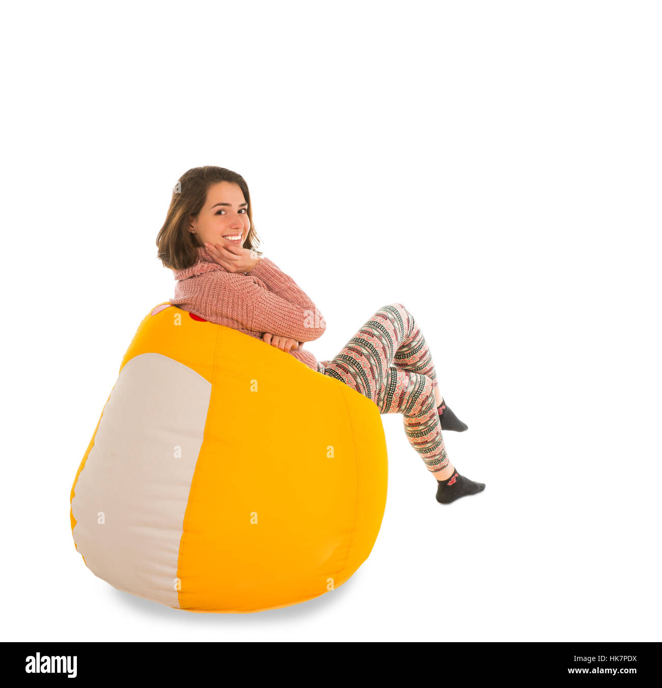 Side View Of Smiling Woman Sitting On Yellow Beanbag Chair For Living Room Or Other Isolated White Background