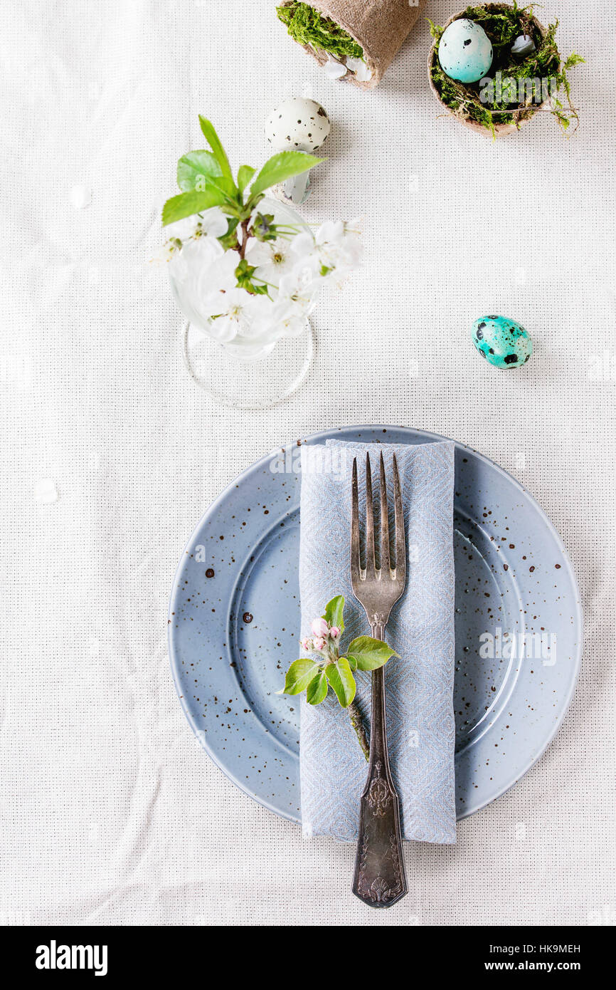 Table setting decor colorful Easter quail eggs with spring cherry ...