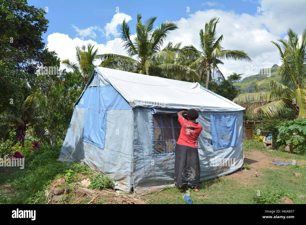BA FIJI - DEC 30 2016Victim of Cyclone Winston live in UNICEF tent in Navala village. Fiji struggles to rebuild a year after Cyclone Winston tropic & BA FIJI - DEC 30 2016:Victim of Cyclone Winston live in UNICEF ...