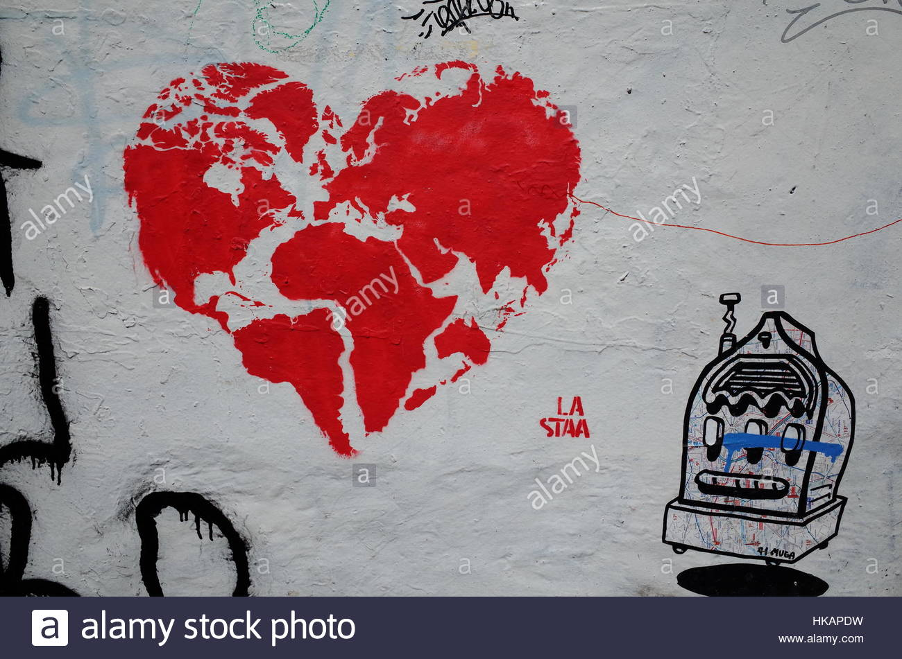 A street art graffiti showing the world map in the shape of a a street art graffiti showing the world map in the shape of a heart on a side street close to the city centre of bergen norway gumiabroncs Image collections