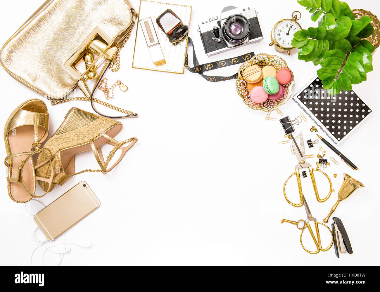 Fashion Flat Lay For Web Site Social Media. Feminine Accessories, Bag,  Shoes, Office Supplies, IPhone And Green Plant On White Table Background