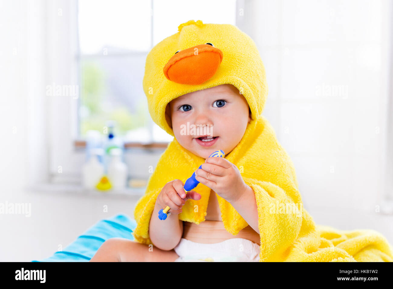 Baby week giveaway 10 angelcare infant bath support andrea dekker - Little Baby In Yellow Duck Towel Brushing Teeth On Changing Table
