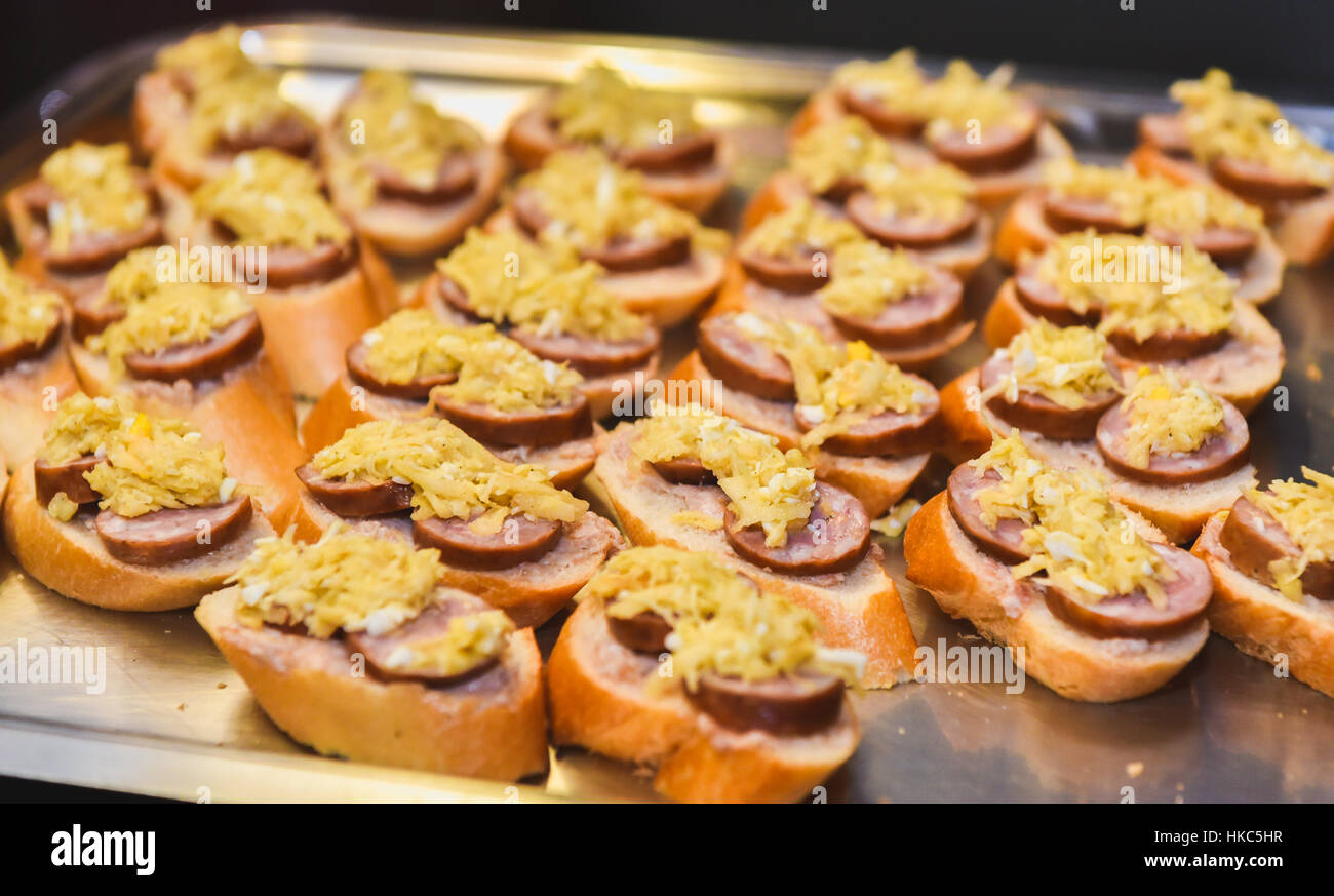Home made canapes small sandwiches appetizers mix of for Canape wraps