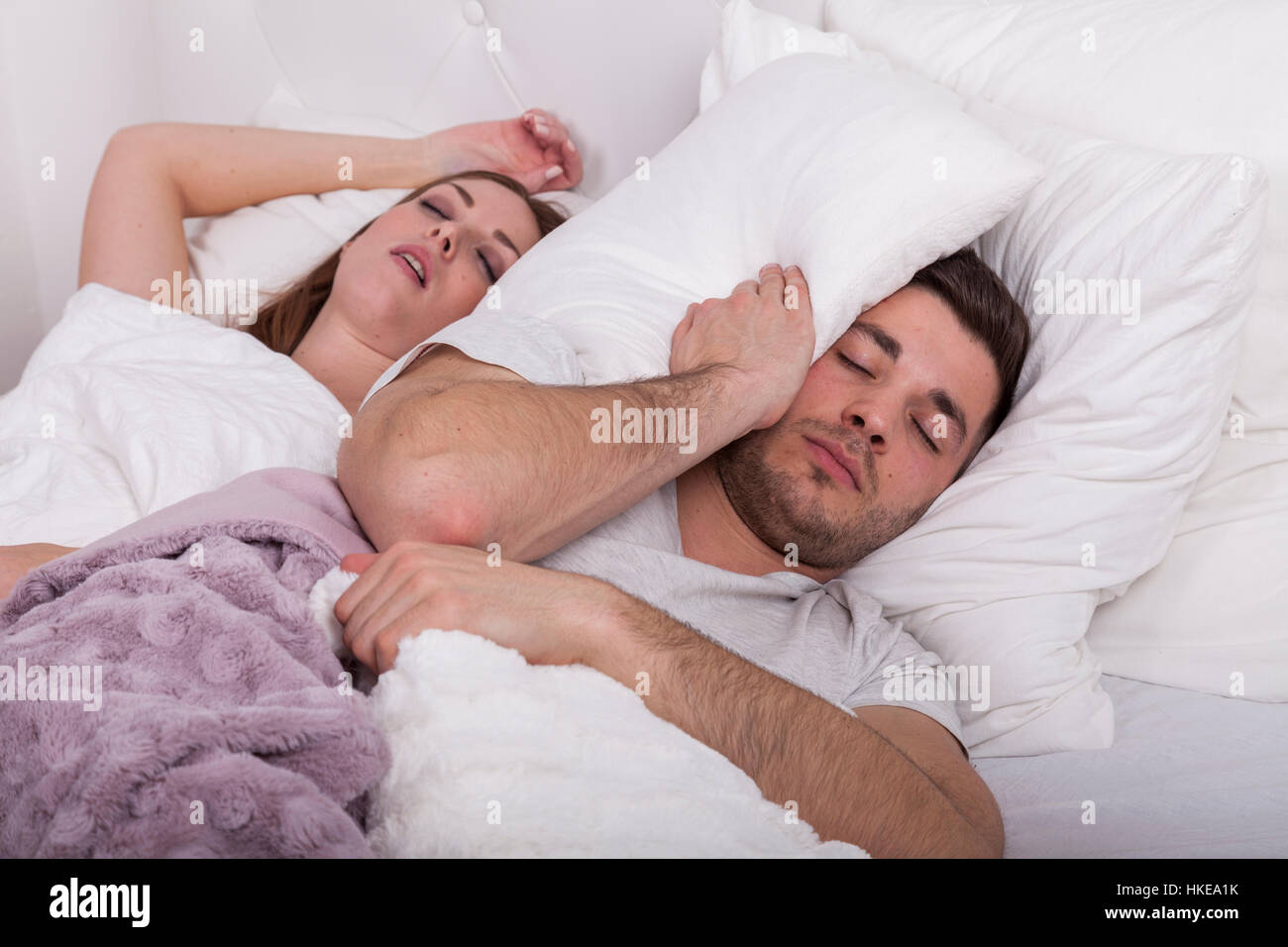 Stock Photo Man Has Problems To Fall Asleep While Woman Snores In Bed Man  Has Problems