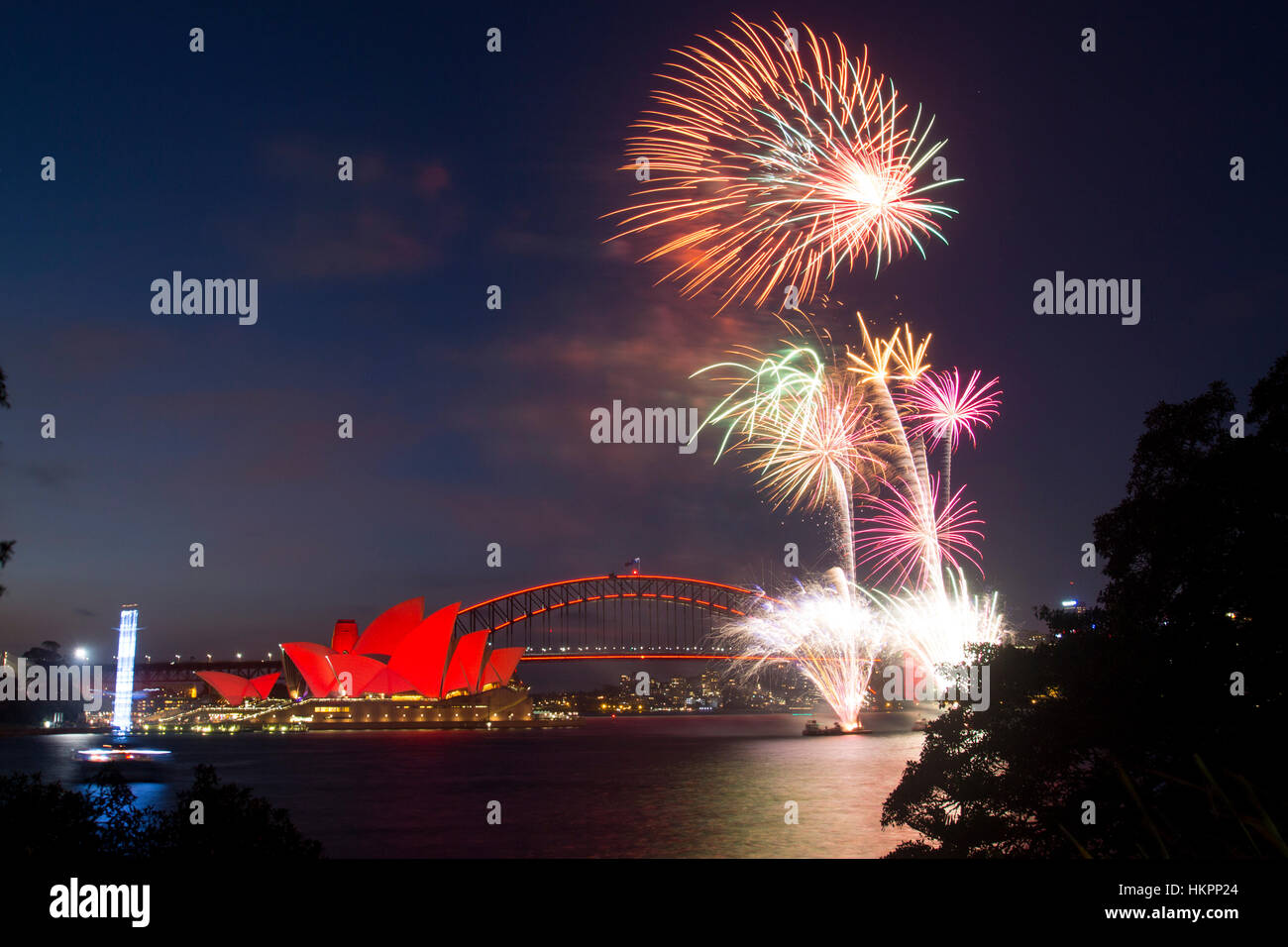 chinese new year fireworks in sydney harbour with bridge and opera house lit up red for the occasion january 2017 sydney nsw australia - Chinese New Year Fireworks