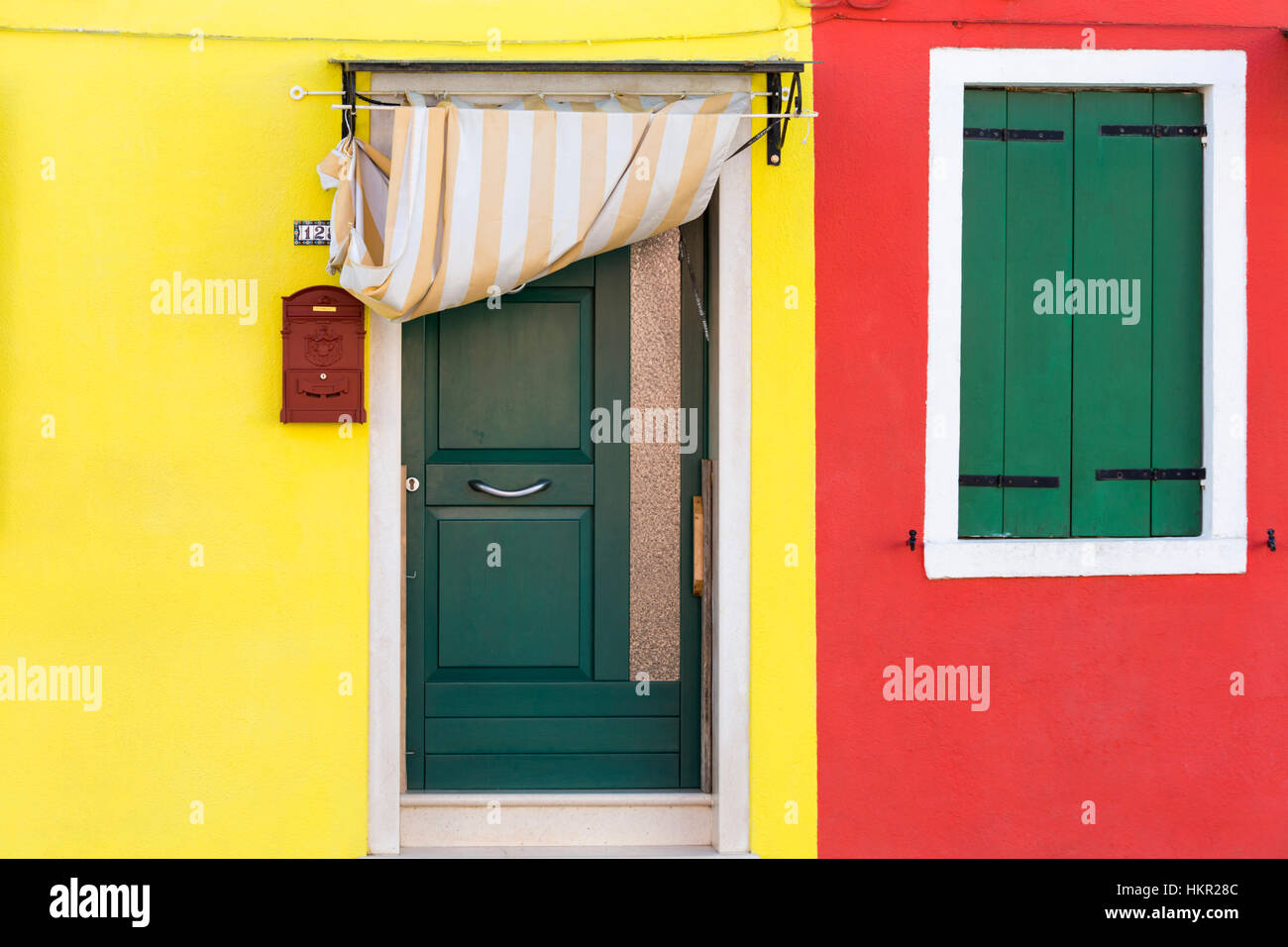 Door and window shutters of brightly coloured adjoining houses at Burano - Bright colors of Burano Venice Italy in January  sc 1 st  Alamy & Door and window shutters of brightly coloured adjoining houses at ...