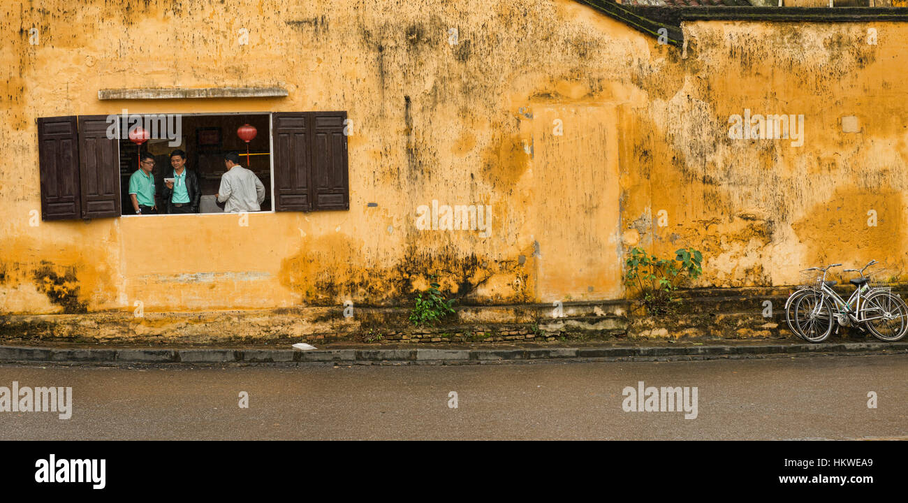 The yellow walls in the picturesque old town of Hoi An, Vietnam ...