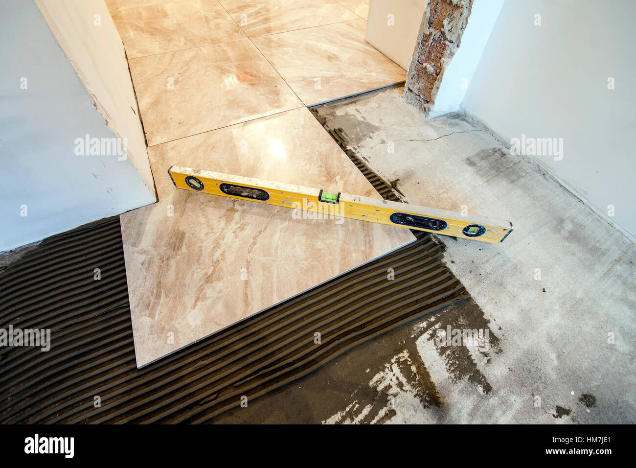 Ceramic tiles and tools for tiler floor tiles installation home ceramic tiles and tools for tiler floor tiles installation home improvement renovation ceramic tile floor adhesive mortar level dailygadgetfo Images