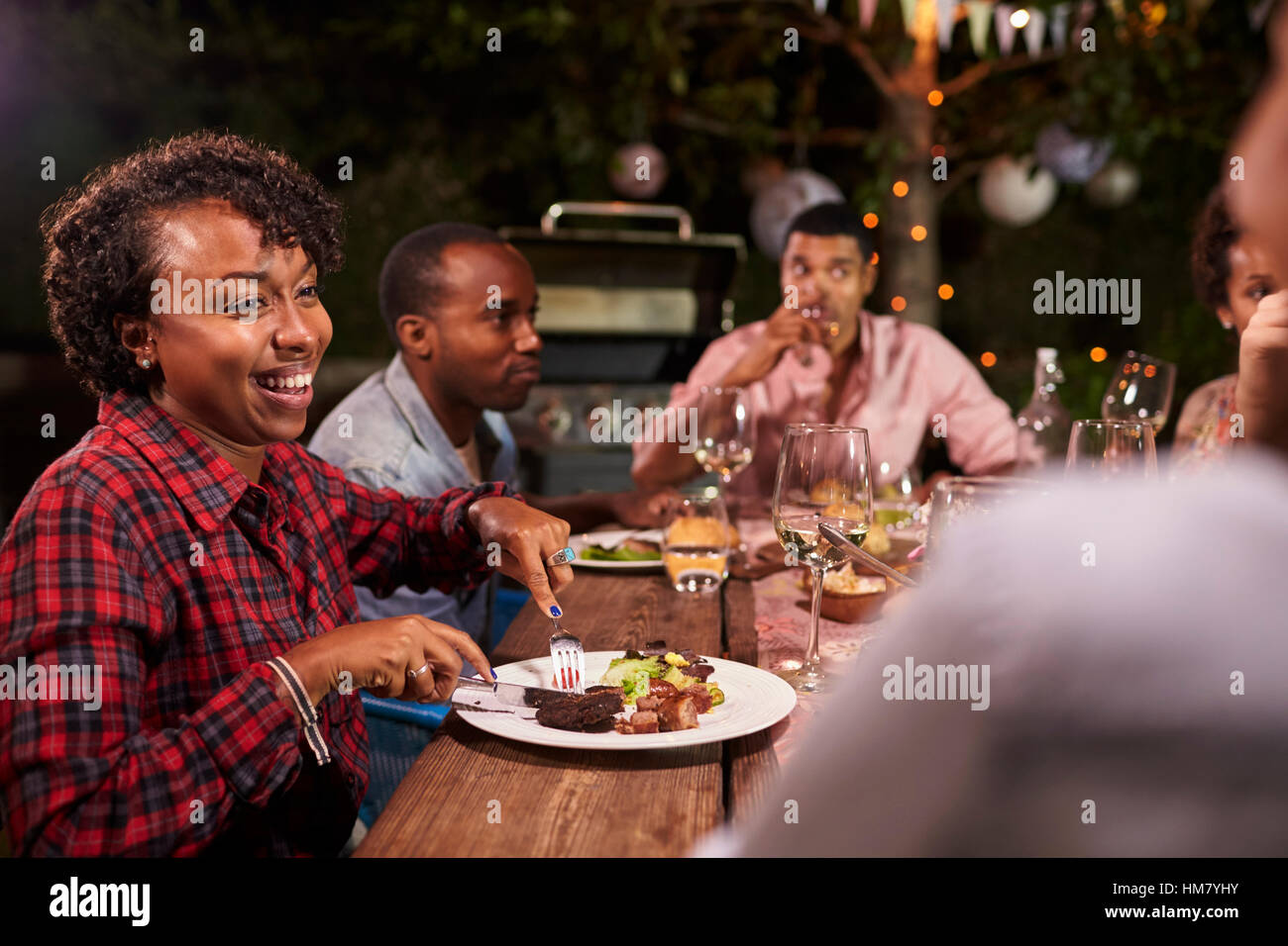 Minneapolis Minnesota USA Adult Black Family Enjoy Dinner And Conversation In Garden