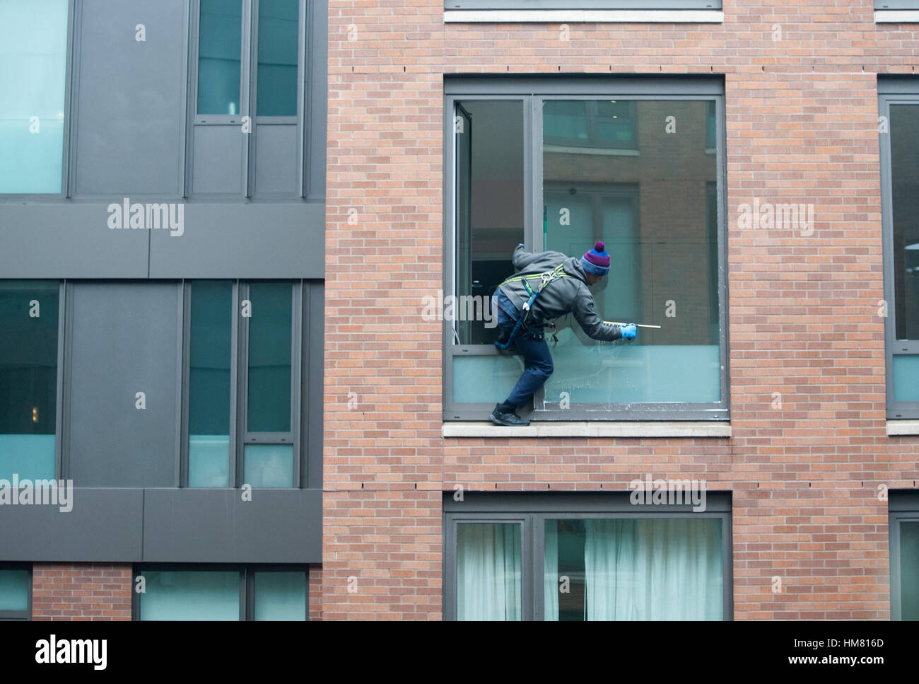 A Man Balanced Himself As He Washed Windows In An Apartment Building In  Manhattan, New York City. Jan. 20, 2017