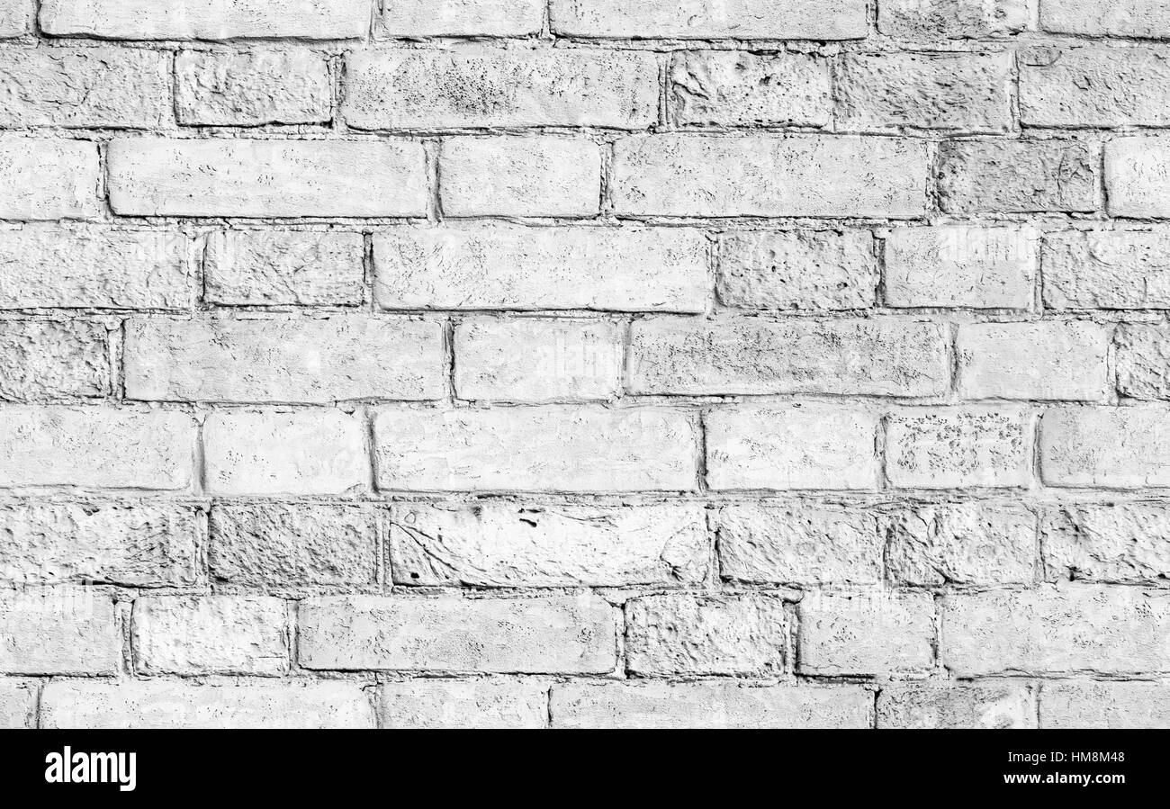 Old weathered white brick wall seamless background photo texture