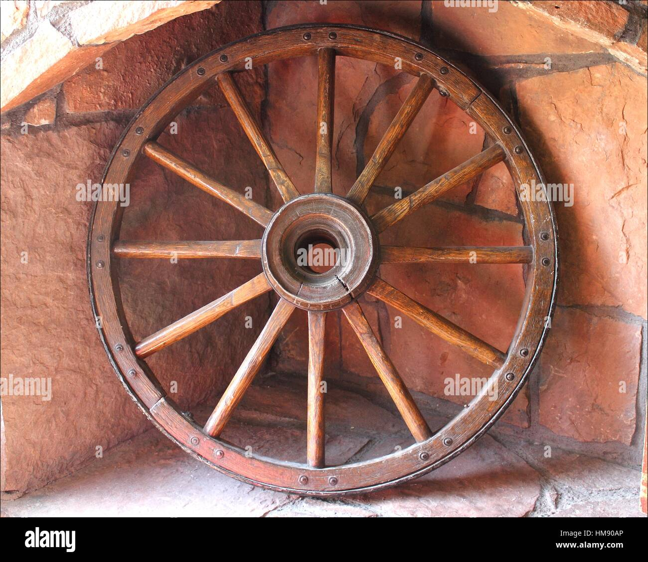 An Old Wagon Wheels Sits In A Stone Hearth In The Grand Canyon, Arizona