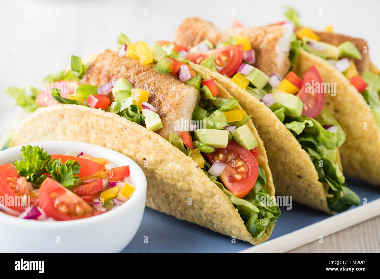 Fish Tacos Shell With Tomato, Beans, Capsicum And Avocado Salsa Stock ...