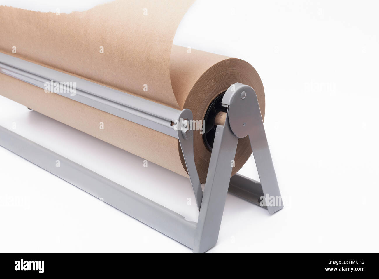Roll of brown craft paper and paper cutter on a white background roll of brown craft paper and paper cutter on a white background jeuxipadfo Choice Image