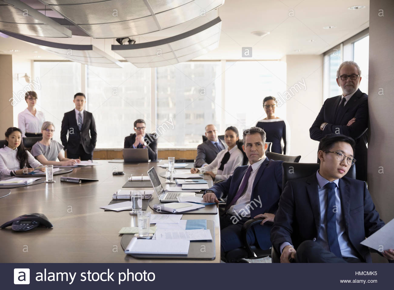 Attentive lawyers listening in conference room meeting ...