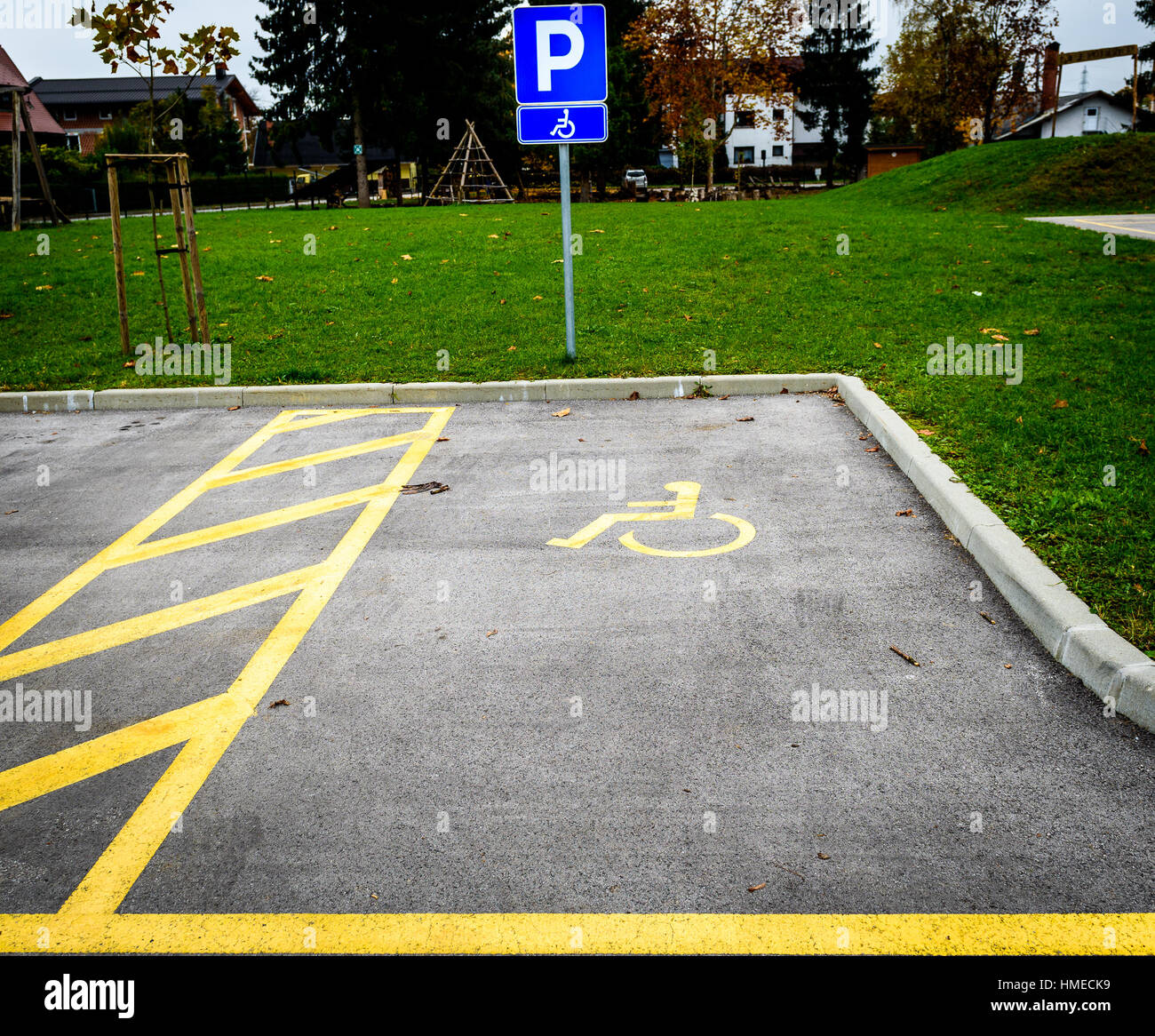 Disable parking space stock photos disable parking space stock wheelchair symbol in a parking lot marks disabled parking space white iconon a blue metal buycottarizona