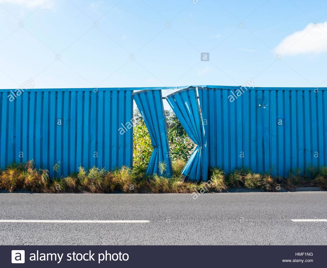 Two blue fence panels damaged on the side of a road in cheshire stock photo two blue fence panels damaged on the side of a road in cheshire uk baanklon Images