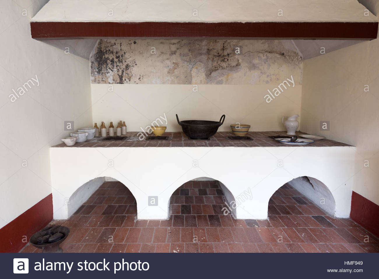 Spanish colonial kitchen in heritage house large hearth for Kitchen utensils in spanish