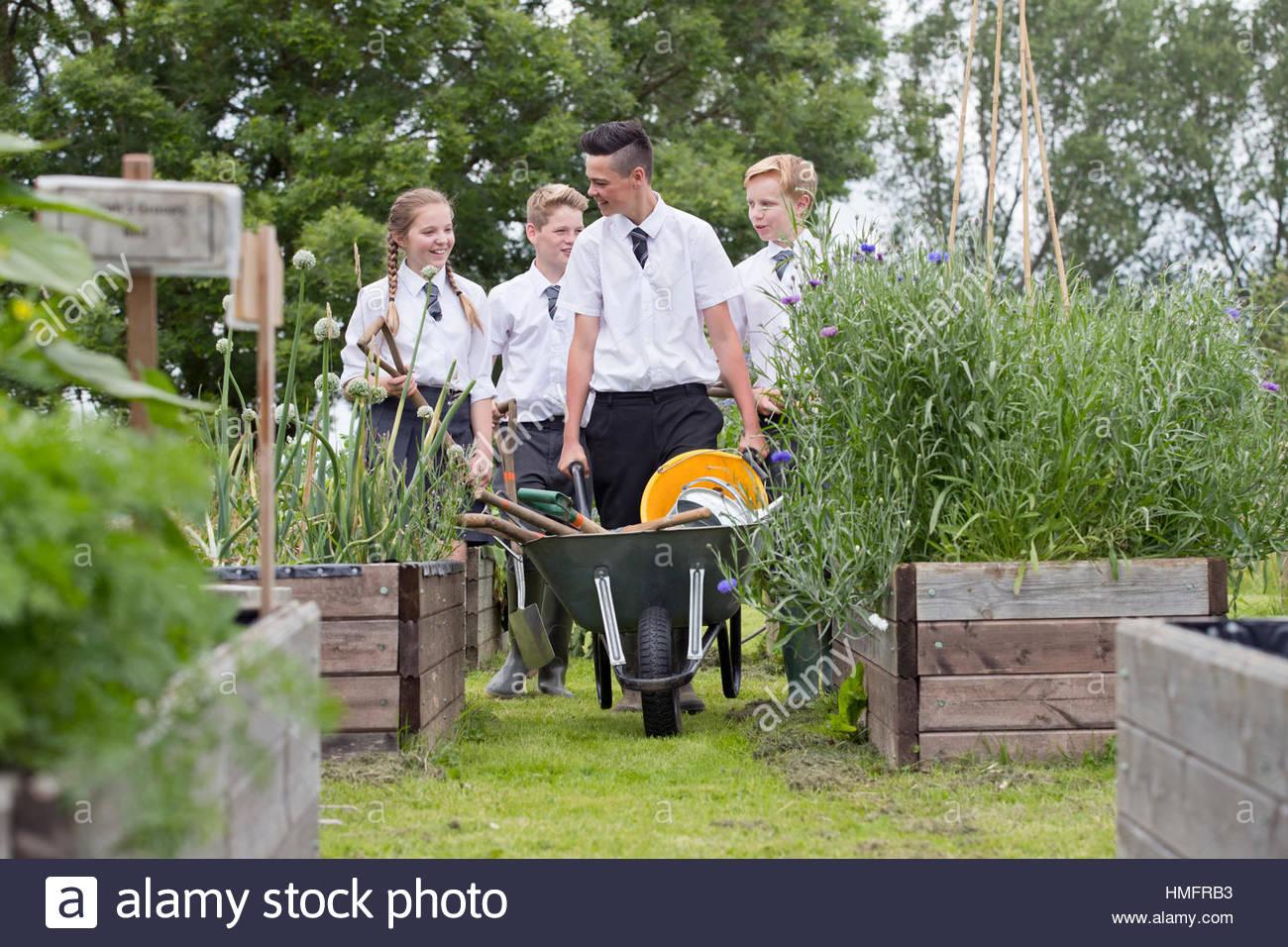 School vegetable gardens - Middle School Students With Wheelbarrow Learning Gardening In Vegetable Garden