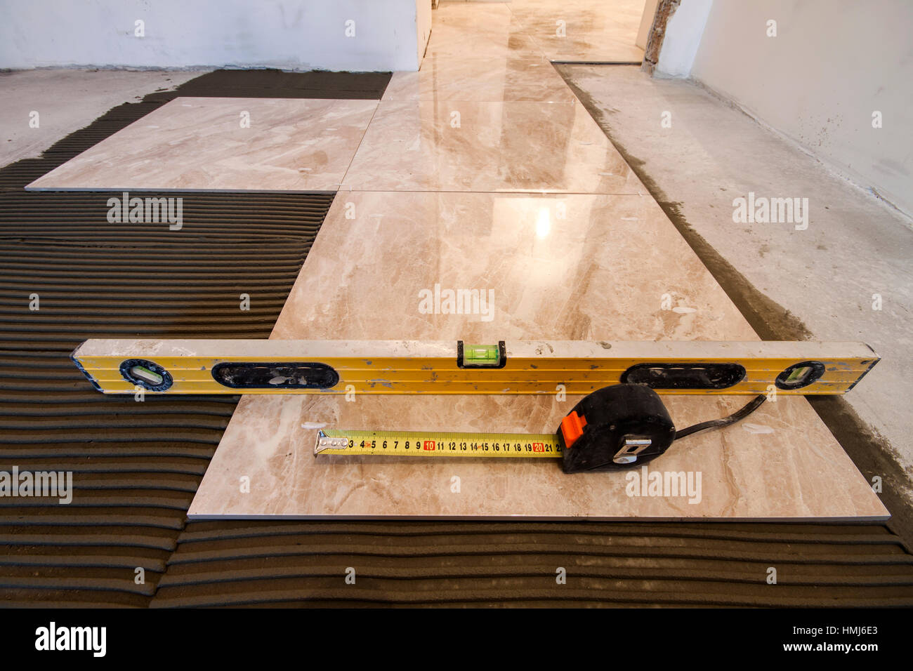 Ceramic tiles and tools for tiler floor tiles installation home ceramic tiles and tools for tiler floor tiles installation home improvement renovation ceramic tile floor adhesive trowel with mortar level me dailygadgetfo Gallery
