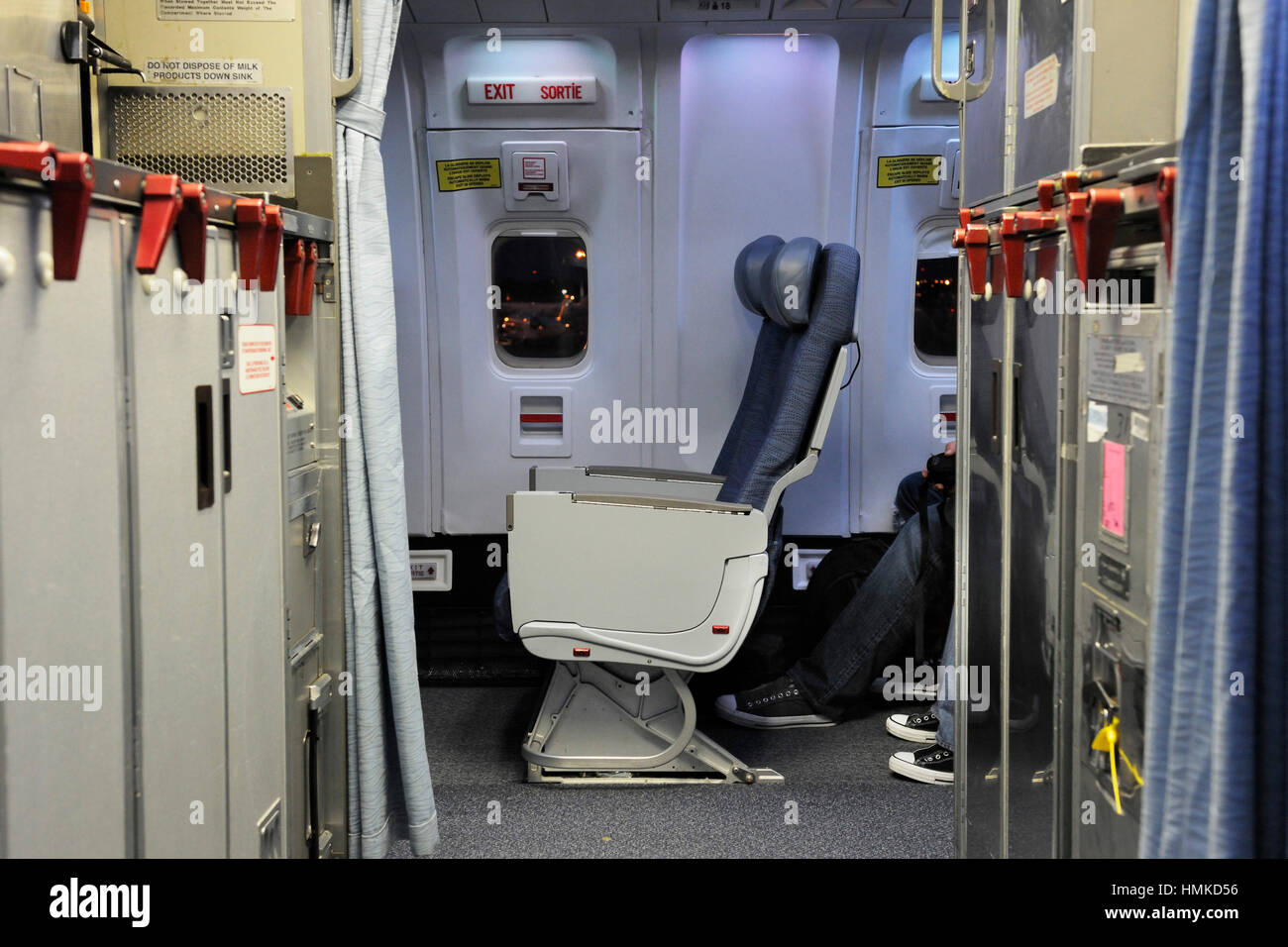 empty economy-class cabin seats by an emergency-exit of an Air Canada Boeing 767-300ER on flight number AC852 YYC-LHR & empty economy-class cabin seats by an emergency-exit of an Air ...