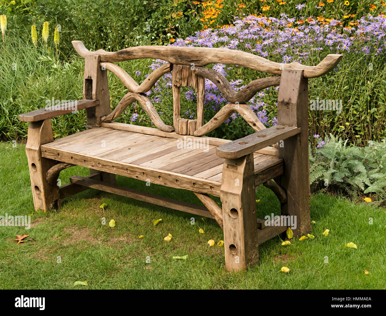 Ornate, Rustic, Wooden Garden Bench Seat Made From Recycled Wooden Parts,  In Front Of Lower Beds, Coton Manor Gardens, Northamptonshire, England, UK
