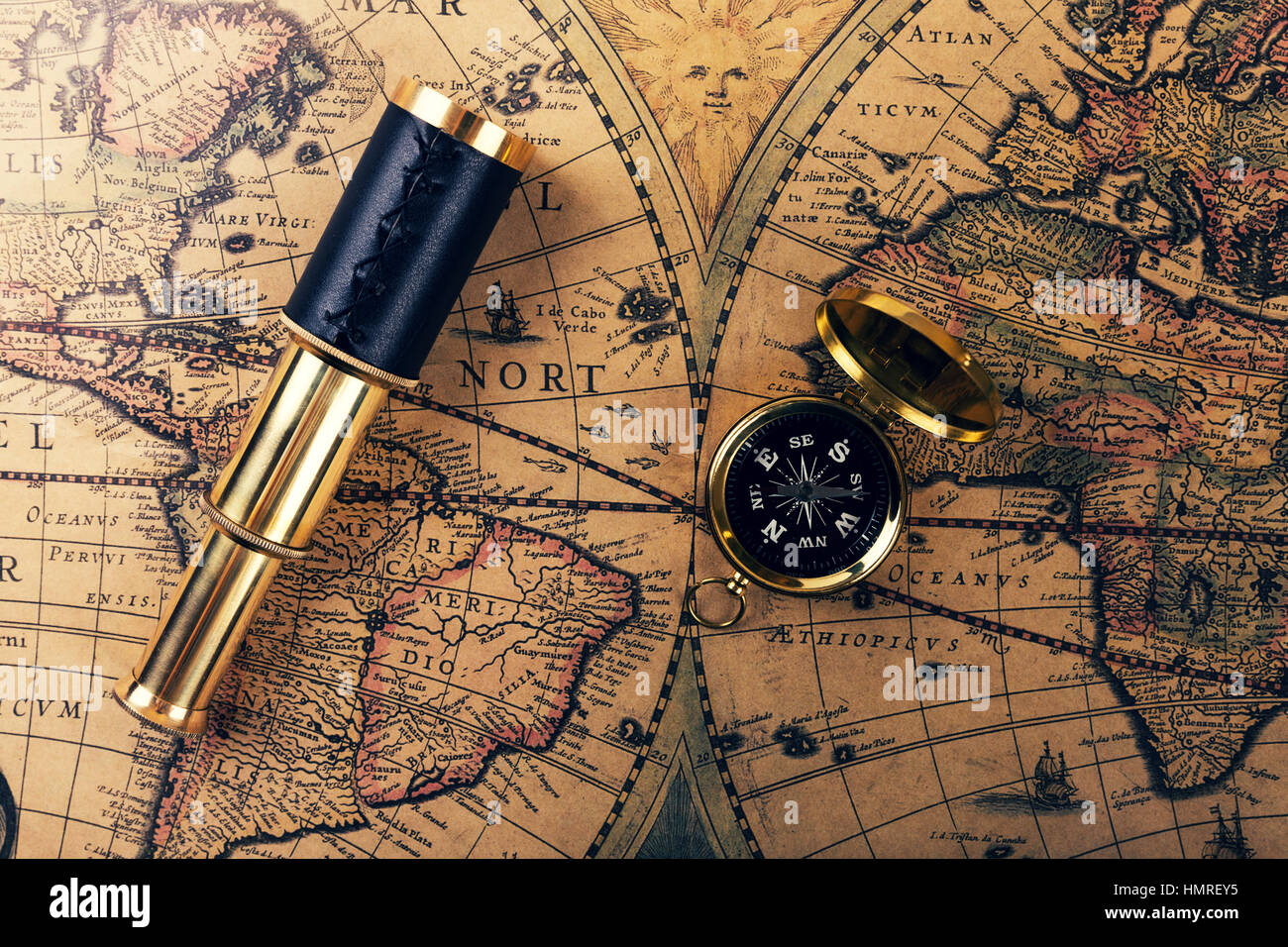 Vintage compass and spyglass on ancient world map stock photo vintage compass and spyglass on ancient world map sciox Gallery