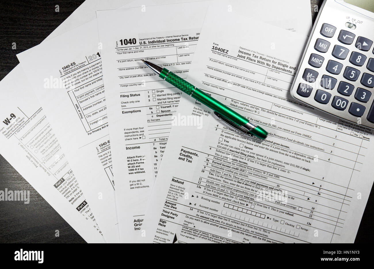 1040 tax return form with a pen stock photo royalty free image 1040 tax return form with a pen falaconquin