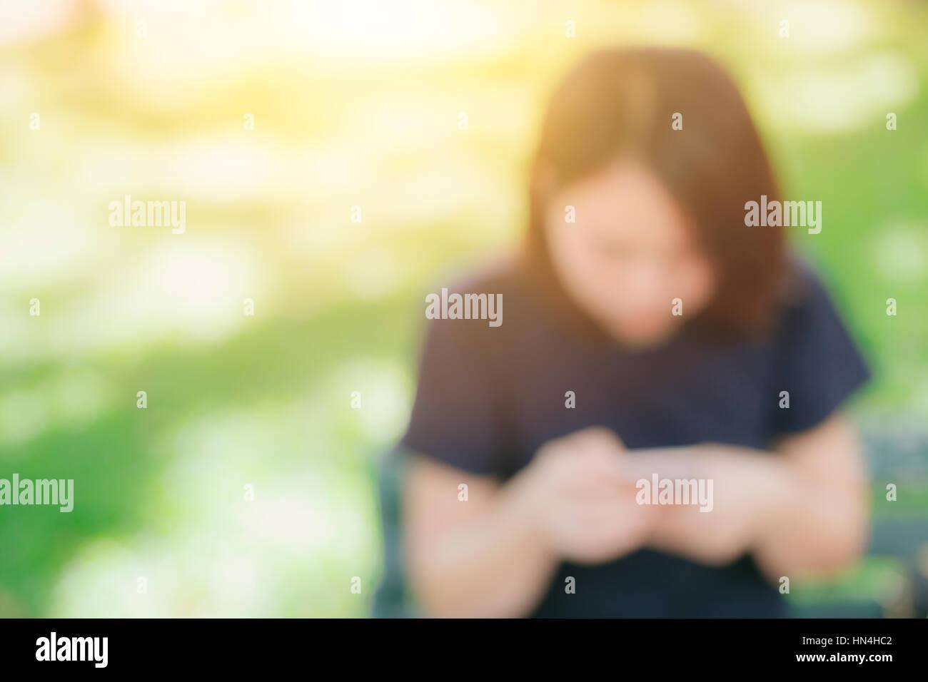 blur teen phone chat for background, Asian girl black short hair ...