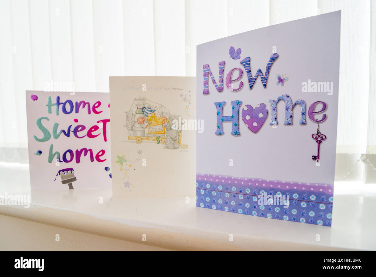 New home greeting cards arranges on a window sill stock photo new home greeting cards arranges on a window sill kristyandbryce Image collections