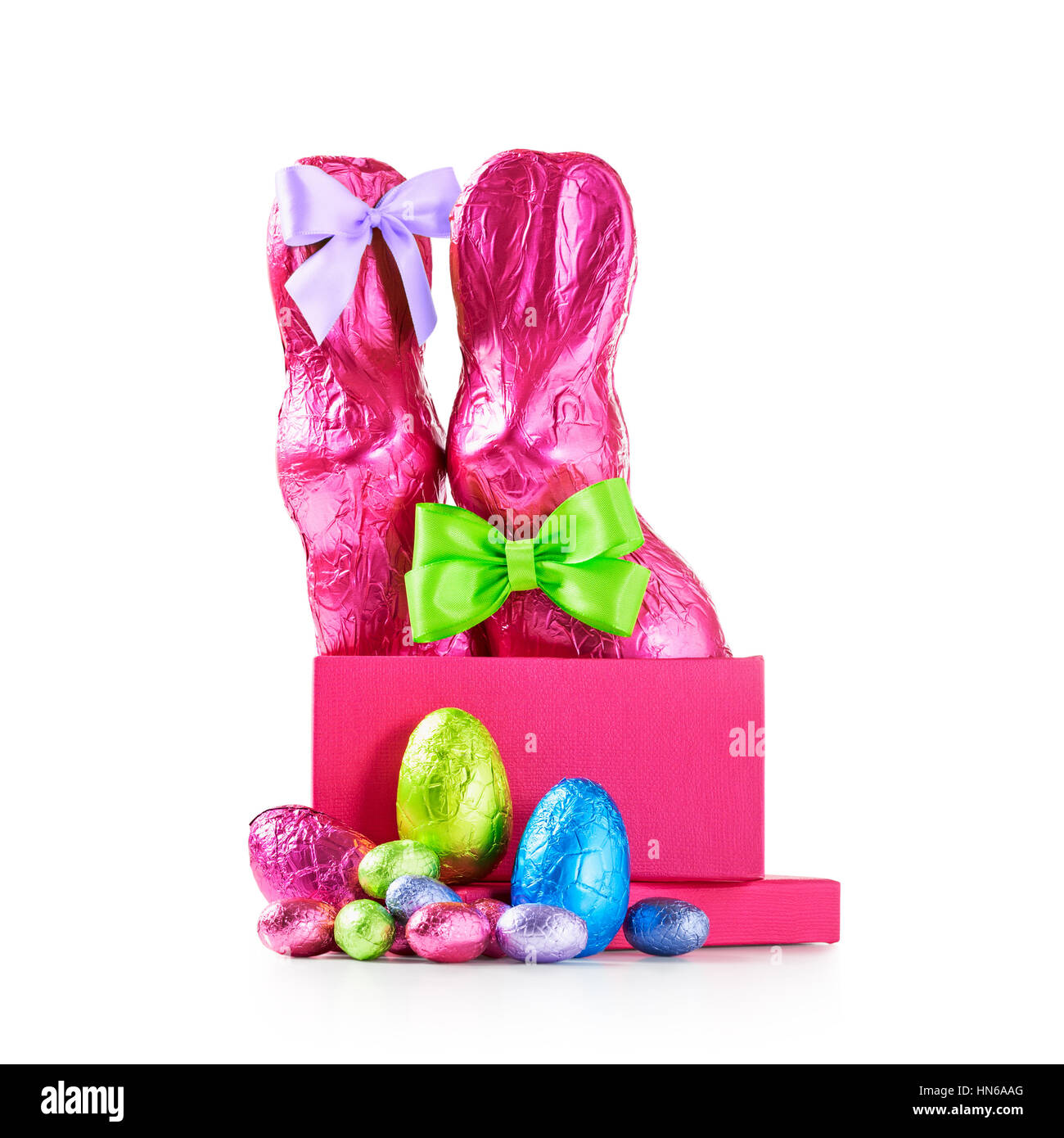 Gift box with chocolate easter eggs couple of rabbits with bow gift box with chocolate easter eggs couple of rabbits with bow wrapped in pink negle Image collections