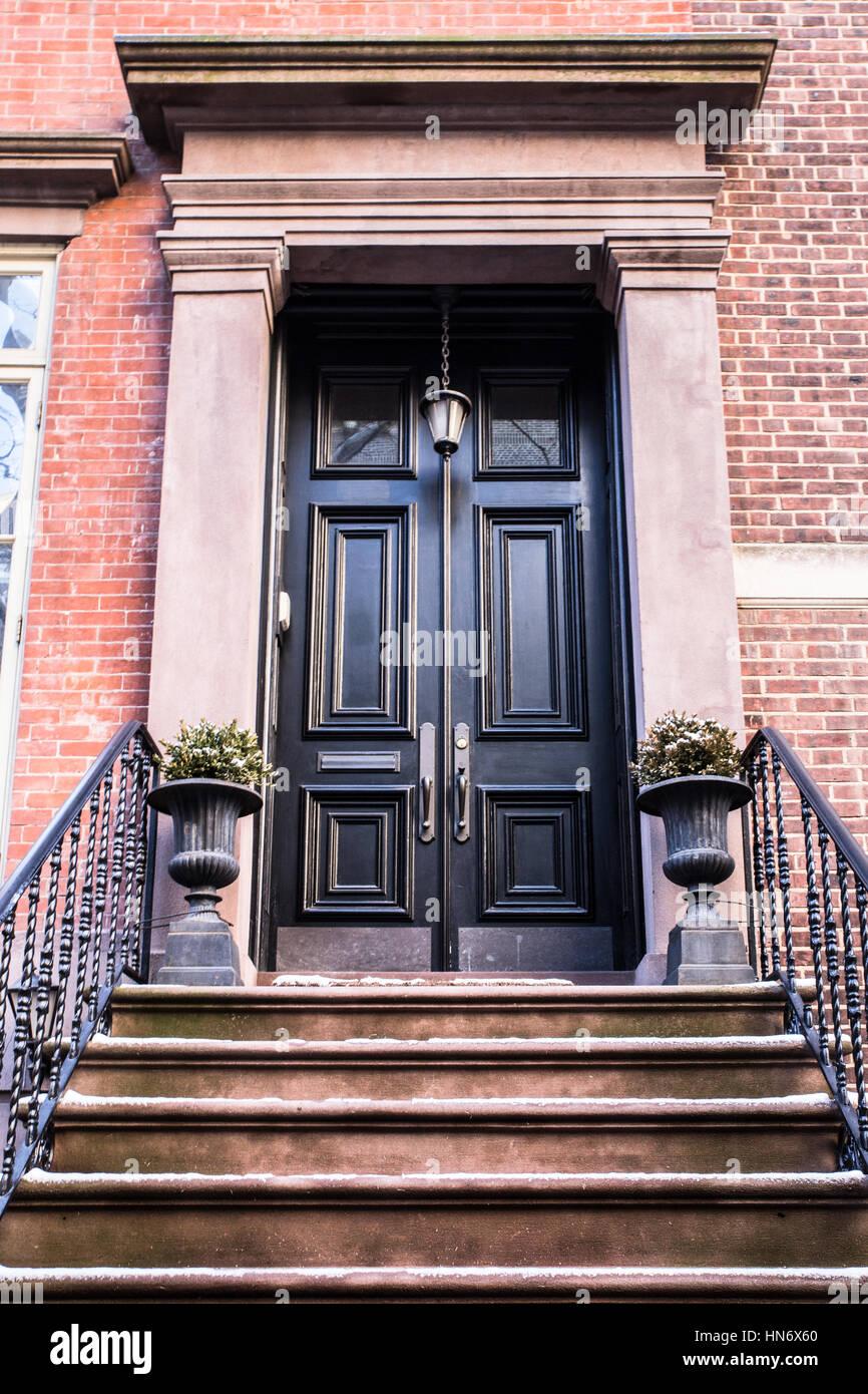 City Apartment Building Entrance typical entrance door to a new york city apartment building stock