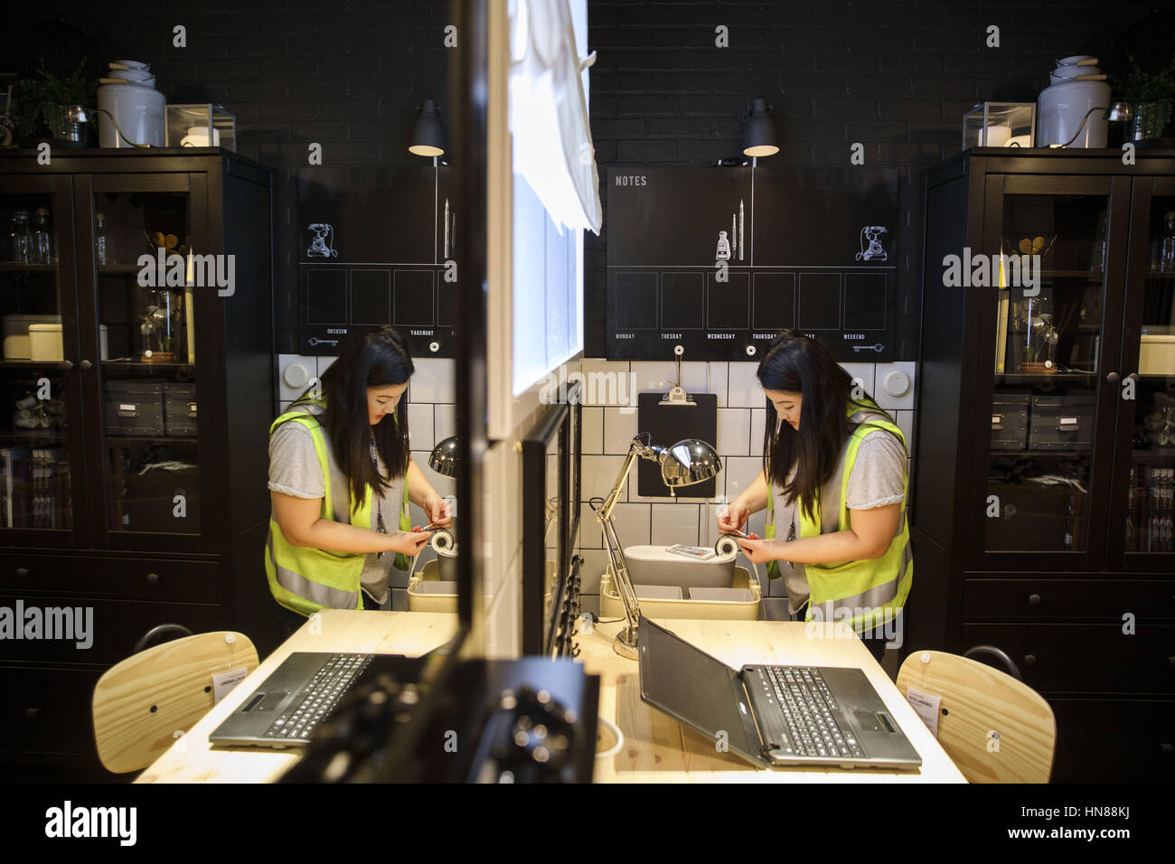 Bena Choe, Interior Designer, Attaches Location Tags To Merchandise During  A Preview Of The New IKEA Burbank Home Furnishings Store On Wednesday, ...