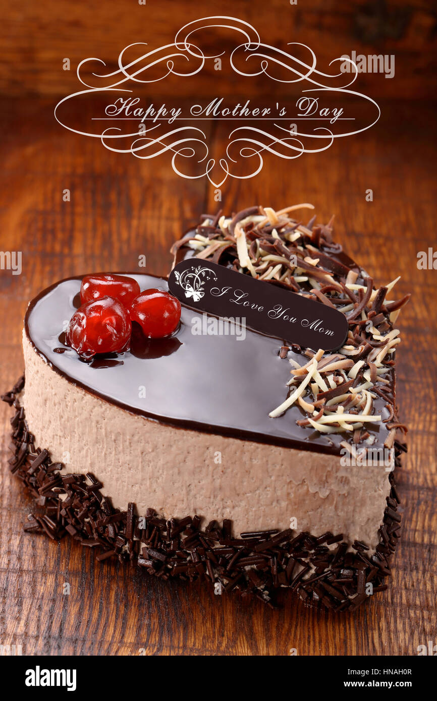 Mother's day chocolate cake in shape of heart with inscription I ...
