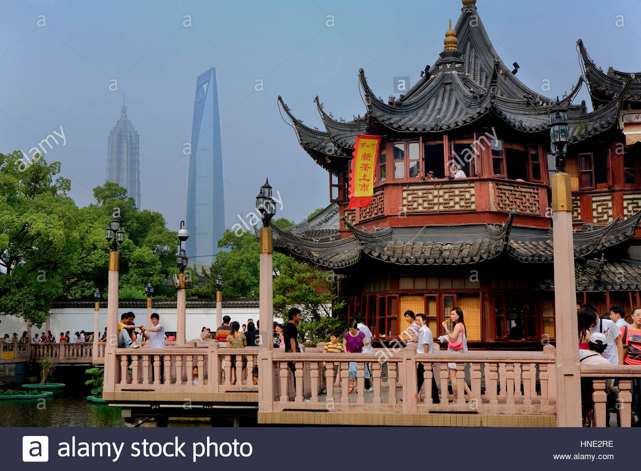 Shanghai: Yu Yuan Bazar. Zigzag Bridge And Huxinting Tea House At Right.  Pudong Skyline In Background With Jin Mao Building And Shanghai World
