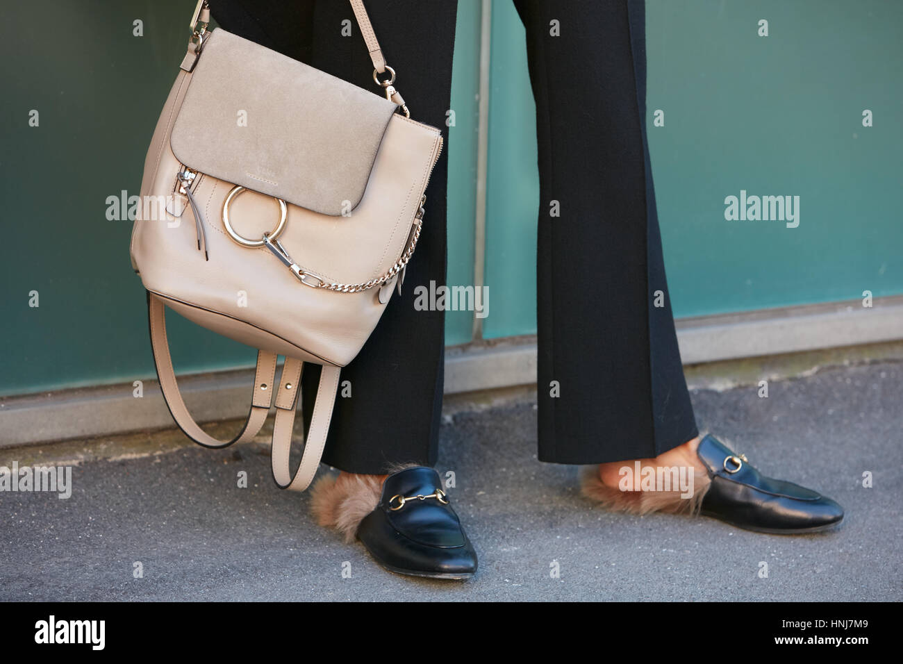gucci bags and shoes. stock photo - woman with beige leather bag and gucci shoes fur before etro fashion show, milan week street style on january 16, 2017 bags