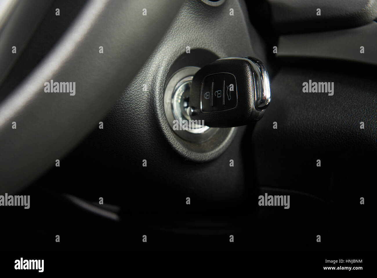 ignition key of modern car close up car key in keyhole stock photo royalty free image. Black Bedroom Furniture Sets. Home Design Ideas