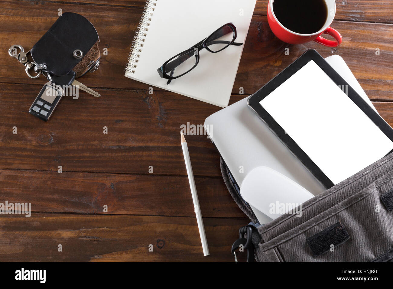car key, laptop computer and tablet on wooden office desk - top