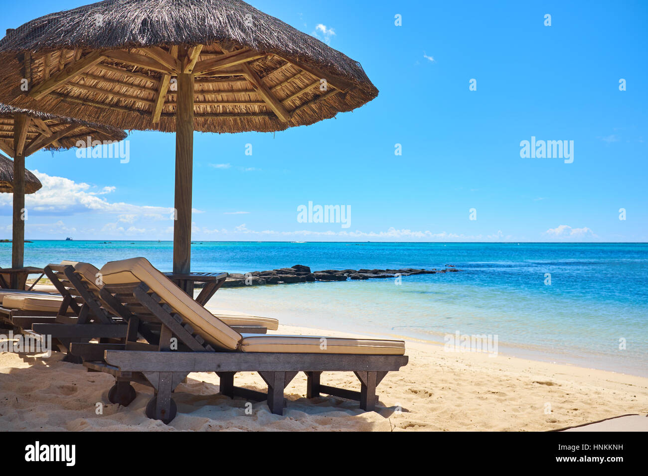 White Sand Beach With Lounge Chairs And Umbrellas In Mauritius I