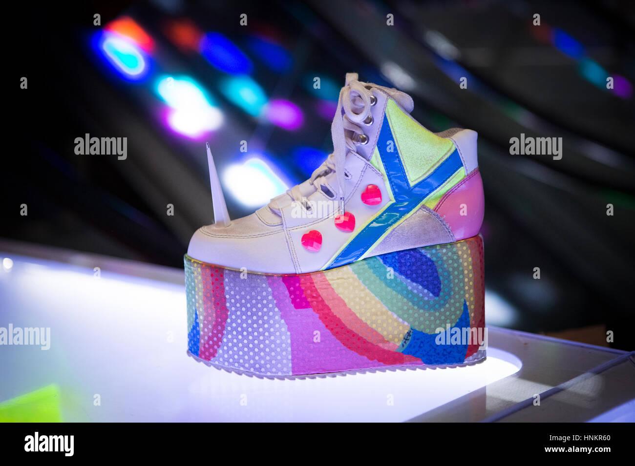 camden market unicorn disco platform shoes in cyberdog stock photo