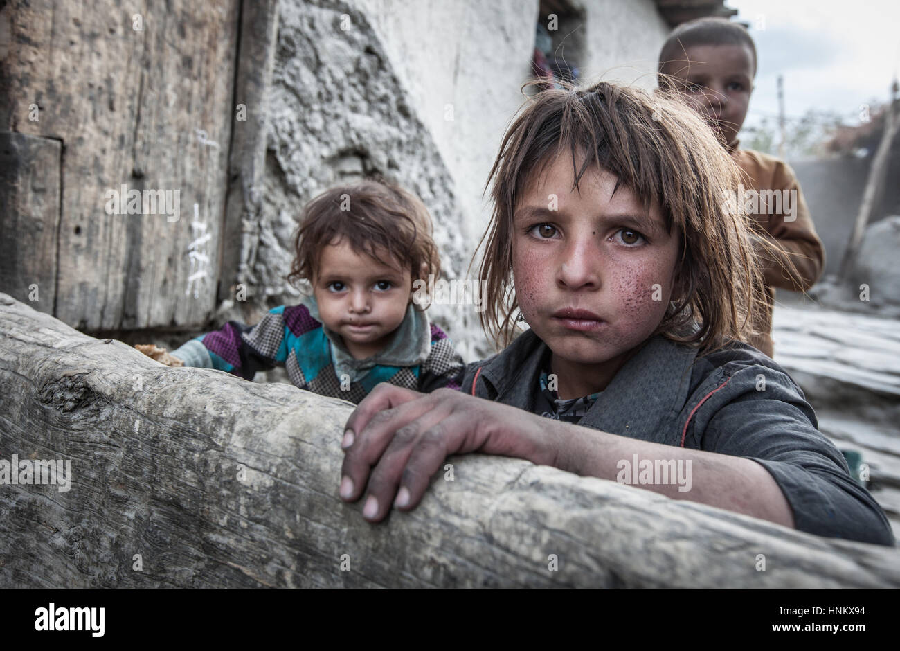 kids poor Afghanistan, Wakhan corridor a portrait of two poor and dirty kids with sad  eyes expression