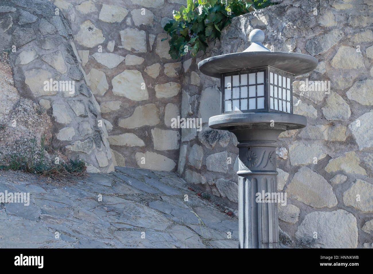 horizontal view of an iron lamppost on a nice stone corner of the ... for Stone Lamp Post  239wja