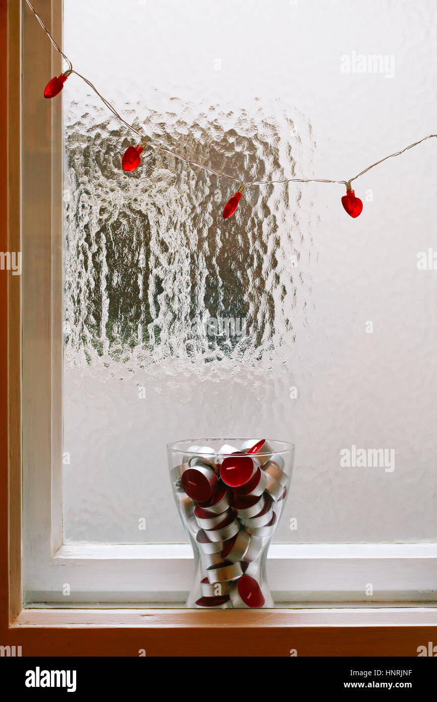 Red heart shaped string lights and a glass vase full of red tea red heart shaped string lights and a glass vase full of red tea light candles in between window frames reviewsmspy