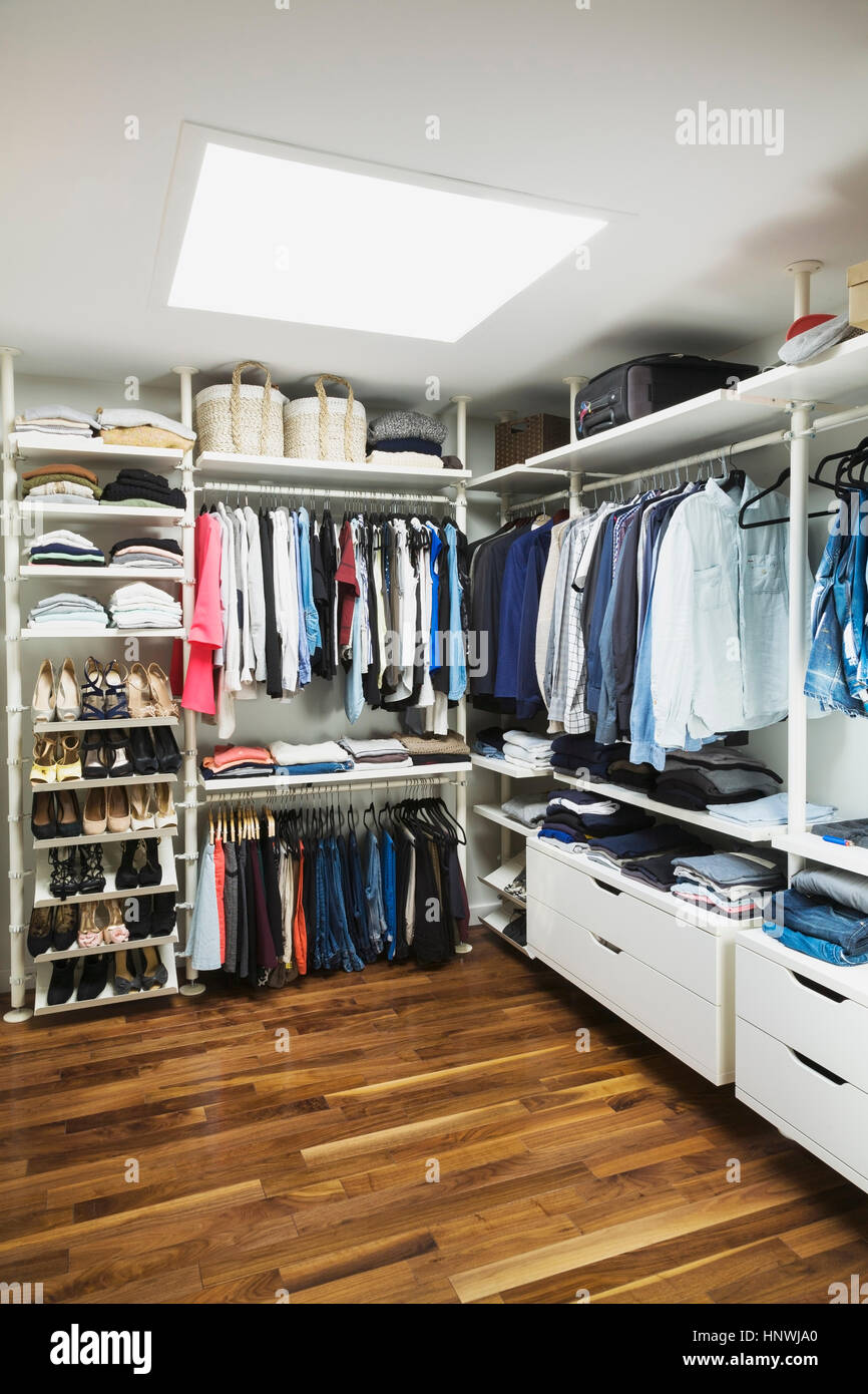Walk in his and hers closet with skylight window and for His and hers walk in closet