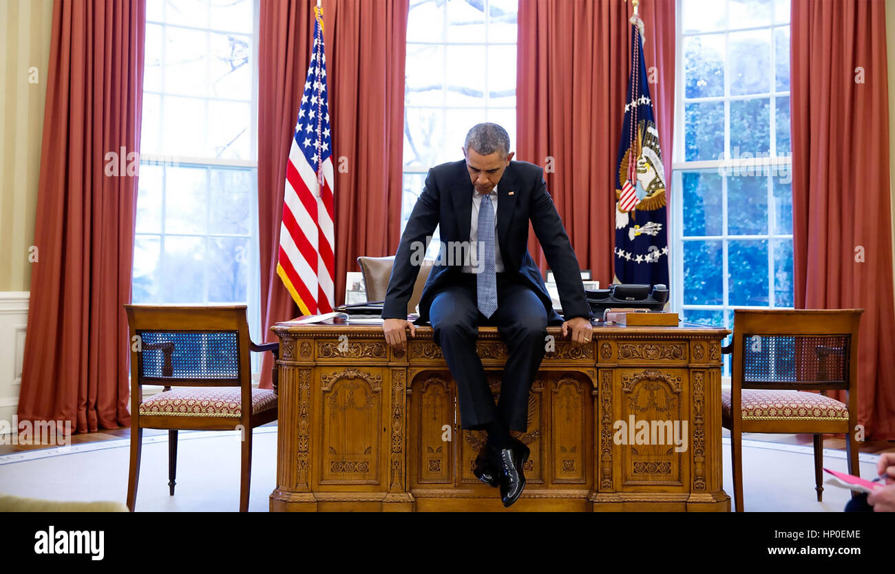 PRESIDENT BARACK On His Desk In The Oval Office Before A
