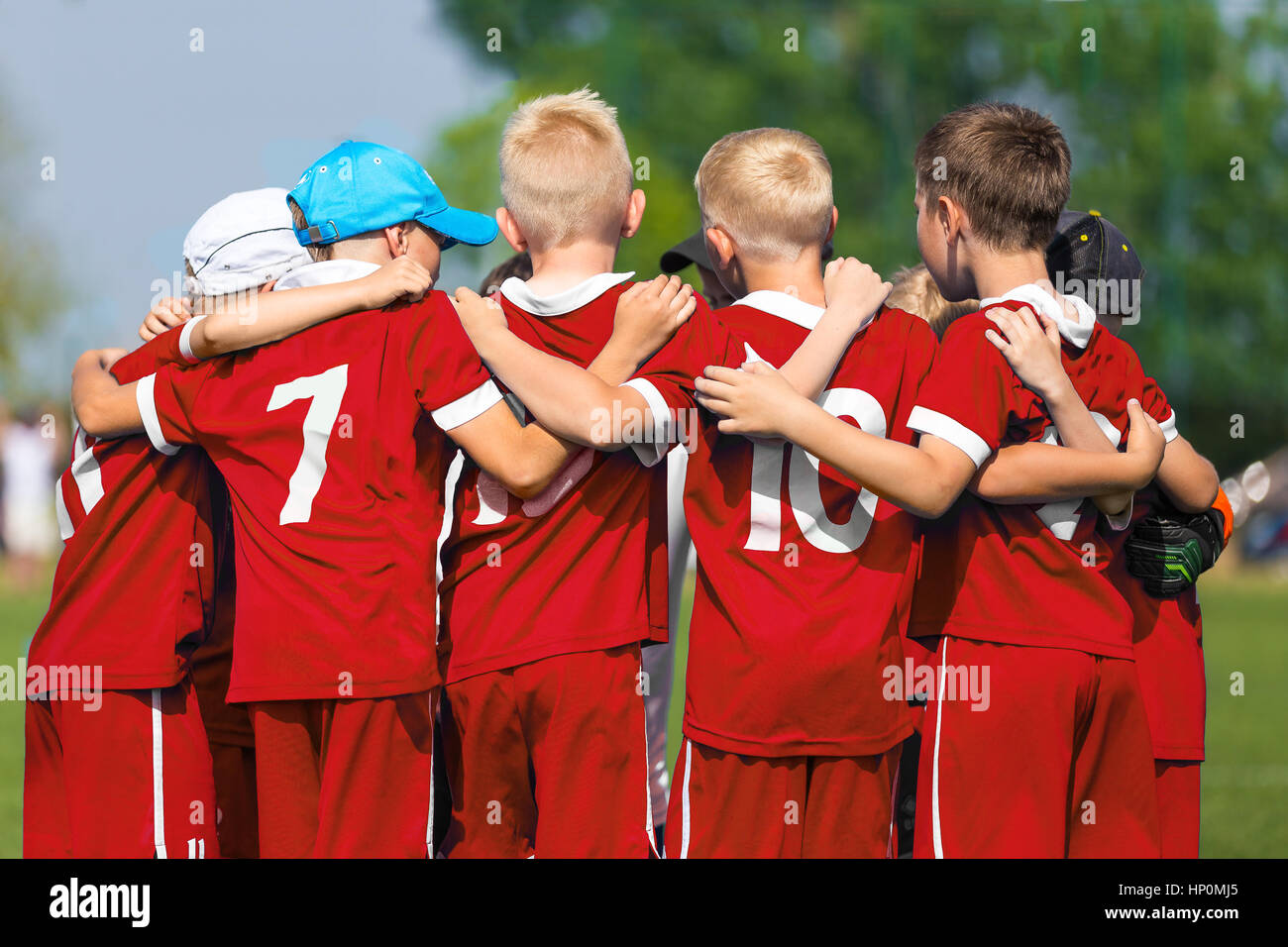 Soccer team huddle kids
